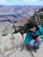 Examining a surveying benchmark at the Grand Canyon